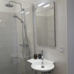 Bathroom of bedroom air with modern washbasin and nice Italian shower