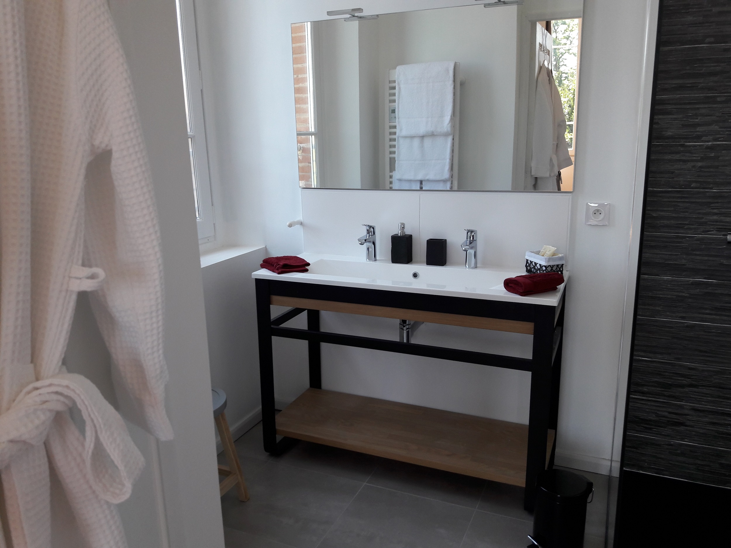 High standard bathroom with double basin sink, Italian shower and bathrobes