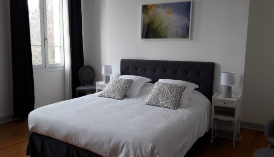Beautiful guestroom with great comfort king size bed and decoration in the shades of grey