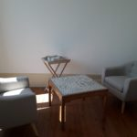 Cosy lounge of the suite with comfortable armchairs, coffee table and courtesy tray