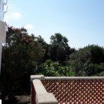 Terrasse de la suite Quintessence avec vue sur le jardin