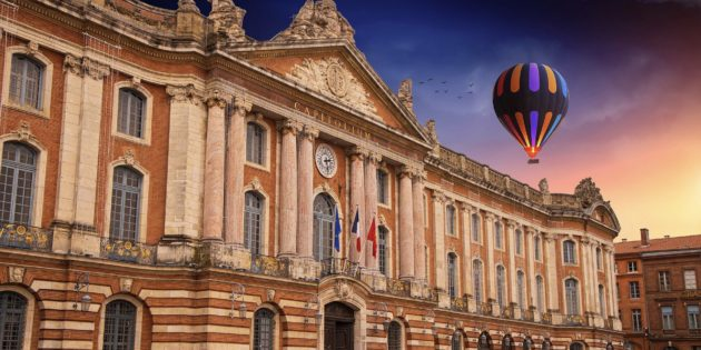 Beautiful capitole square in Toulouse, Haute Garonne and its red bricks buildings