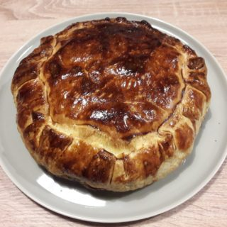 Homemade confit duck pie served for dinner at the table d'hotes