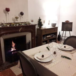 Lovely table for New Year's Eve by the fireplace