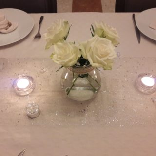 Refined table setting with flowers for table d'hotes dinner
