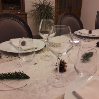 Beautiful natural and refined decoration for New Year'sEve dinner table