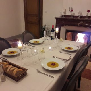 Elegantly dressed dinner table by the fireplace