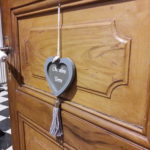 Beautiful original wooden door of guest room Earth located on the ground floor of the B&B