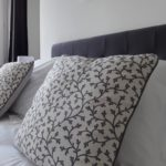 Very comfortable bed of guest room Air with soft pillows and refined cushions