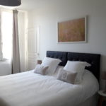 Guest room earth with very comfortable king size bed and soft pillows