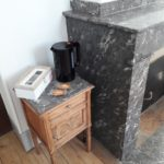 Small table by the fireplace with kettle, biscuits, tea and coffee facilities